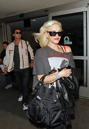 Gwen Stefani made her way out of LAX airport donning a cool nylon tote bag.