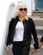 Gwen Stefani styled a plain white tee with an edgy-chic zip-up jacket for a lunch out with her family.