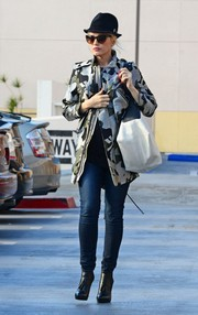 Gwen Stefani looked tough-chic in a metallic camo-print jacket while shopping in Studio City.