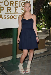 Kaley completed her flirty navy dress with chunky nude boots.