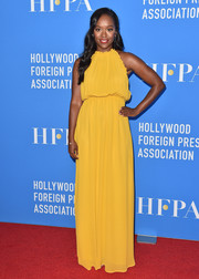 Aja Naomi King brightened up the red carpet with this canary-yellow maxi dress by Reformation during the HFPA Grants Banquet.