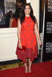 America Ferrera attended the HFPA Grants Banquet wearing a delightful A.L.C. handkerchief-hem print dress in two shades of red.