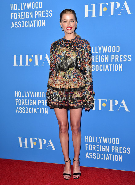 Amber Heard sealed off her look with simple black sandals, also by Saint Laurent.