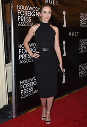 Emily Blunt styled her dress with two-tone ankle-strap sandals by Casadei.