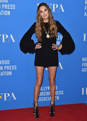 Elizabeth Chambers was all legs in a short black dress with blouson sleeves at the HFPA Grants Banquet.