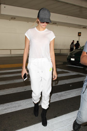 Hailey Baldwin matched her top with a pair of white sweatpants.