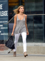 A fringed black tote finished off Hailey Baldwin's look.