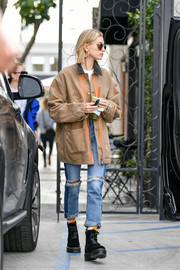 Hailey Baldwin sealed off her ensemble with a pair of black velvet boots by Dr. Martens.