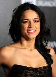 Michelle Rodriguez topped off her look with a sweet side sweep when she attended the Haiti Carnival in Cannes.