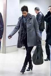 Halle wears a gray shearling leather coat at the LAX airport.