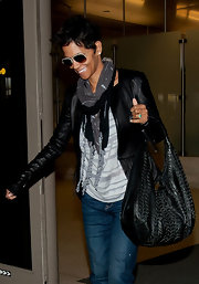 Halle Berry matched her easygoing style with a slouchy braided leather hobo.