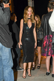 A pair of black skinny-strap sandals finished off Halston Sage's head-turning outfit.