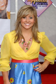Shawn Johnson topped off her colorful floral-themed ensemble with an eye-catching statement necklace at the 'Hannah Montana' premiere.