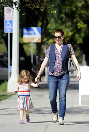 Alyson Hannigan brought back the early '90s in a floral blouse and navy blue vest.