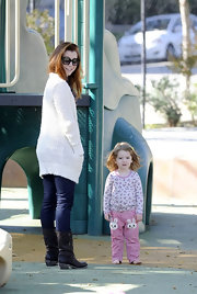 Alyson Hannigan was spotted with daughter Satyana in a cozy cream sweater paired with flat leather boots with buckled detailing.