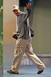 Tom Hardy keeps things casual at the airport in a pair of loose fitting cargo pants.