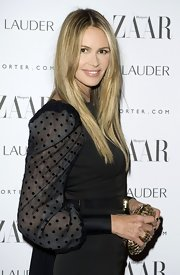 Elle MacPherson looked stunning at the 'Harper's Bazaar' Women of the Year Awards with her long tresses sleek and straight.