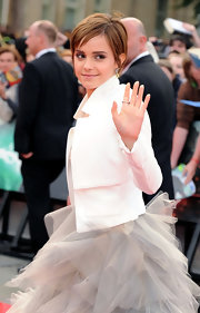 Emma donned a sleek white blazer over her frothy dress at the UK 'Harry Potter' premiere.