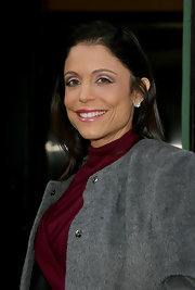 Bethenny Frankel added a bright pearly pink lipstick to her look before going out in NYC.