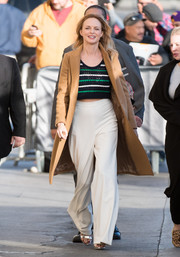 Heather Graham teamed her top with a pair of white wide-leg pants.