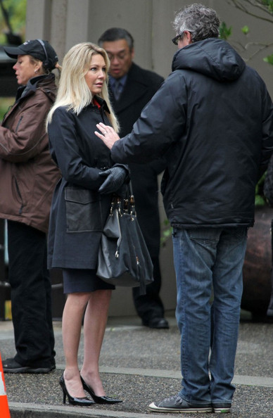 Heather Locklear wore black patent pointy-toe pumps on the set of her new film. The timeless pumps paired perfectly with her black gloves and pea coat.