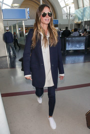 Heidi Klum finished off her ensemble with white calfskin sneakers by Chanel.