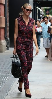 Heidi hit the streets looking chic as ever in a sleeveless patterned jumpsuit.