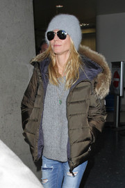 Heidi Klum was spotted at LAX looking cozy in a gray wool cap and a puffer jacket.
