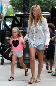 Heidi Klum got tropical in a palm tree-printed button down and denim shorts.