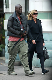 Seal threw on a fitted black down jacket while taking a stroll with wife, Heidi Klum.