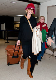 Katherine Heigl stepped out in cognac knee-high wedge boots.