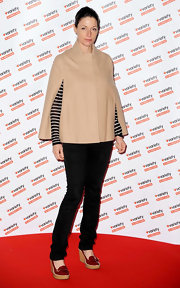 Mary covered up in a fashionable camel cape at the Hidden Gems Photography Gala in London.