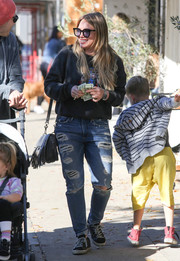 Hilary Duff looked cozy in a graphic gray sweater while out and about in LA.