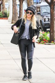 Hilary Duff toughened up her gym attire with a black leather moto jacket.