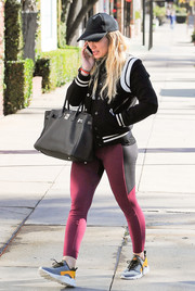 Hilary Duff continued the athletic vibe with a pair of purple and black leggings.