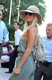 Paris Hilton took some notes from JLo in a cream floppy hat and mint blue jumpsuit. Groovy!