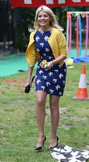Hollyw Willoughby rocked a palm tree-print sheath dress while out in London.