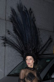 Lady Gaga brought a bit of Las Vegas to London with this showgirl headdress by Louis Vuitton.