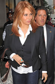 Raquel Welch showed up at the 'Hot in Cleveland' premiere wearing blazer and vest on top of a crisp white undershirt.
