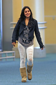 Vanessa Hudgens wore a pair of white super shredded skinny jeans to the airport.