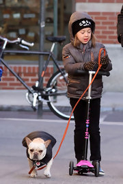 Ava Jackman went out for a scooter ride cozily bundled up in a brown puffer jacket.