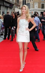 Rosie showed off her long legs with this white strapless mini dress that featured silk embroidery.