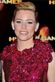 Elizabeth Banks wore her hair in a classic bun with her lengthy bangs swept back for the French premiere of 'The Hunger Games.'