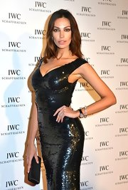 Madalina Ghenea carried a satin box clutch to the IWC and Finch dinner.