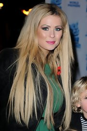Nicola McLean wore her blonde hair down at a movie premiere.