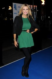 Nicola Mclean made her mini dress night-friendly by wearing thick black tights underneath.