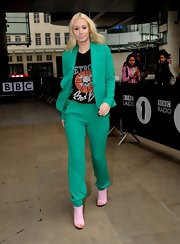 Iggy Azalea rocked a bright emerald green pantsuit over a graphic tee.