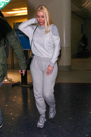 Iggy Azalea covered up in a comfy gray sweater for a flight.
