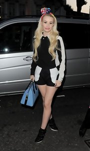 Iggy chose black-and-white shorty shorts to pair with her button down.