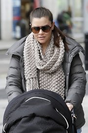 Imogen Thomas stepped out in London wearing a thick loose-weave wool scarf.